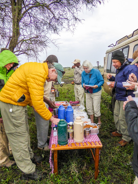 Hot porridge breakfast on a chilly morning out on the Serengeti plains by Ling Ma in Mar 2017.