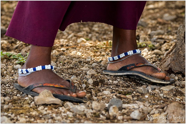 Maasai beadwork, weaved by women! They wore sandals made of cowhides but the world's changed, sandals with soles made of tire strips are also fine.