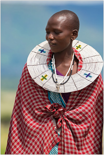She looks beautiful with a big beaded collar. Each color of bead represents something meaningful. In this case, Blue - sky/rain. White - color of milk, peace. Green - plants. Yellow/orange - the sun, growth, hospitality.