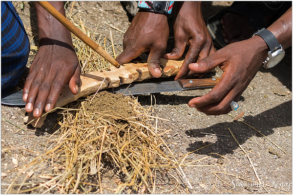 The fire making demonstration, by Maasai tribesmen, the friction between straightened wooden reed, a fire board, dried dung. Just keep spinning it fast !