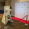 Kiosk set up with physical step and repeat media wall