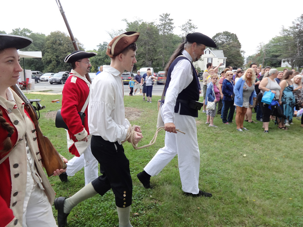 . John Reveruzzi, Dave McKee and Alysha Dunnigan, members of the Yarmouth Minutement, were British soldiers who arrested Michael Kelsey who portrayed Thomas Ditson. Photo by Mary Leach