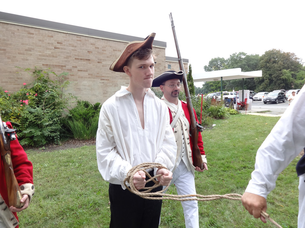 . Michael Kelsey portrayed Thomas Ditson, a Billerica minuteman who had gone to town to buy a musket. He was arrested by British soldiers during a re-enactment of the event. Photo by Mary Leach