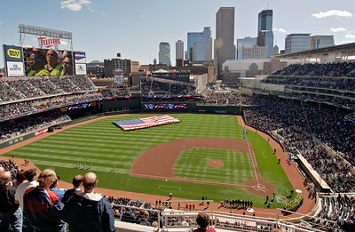 Target Field construction workers display the flag for the National Anthem