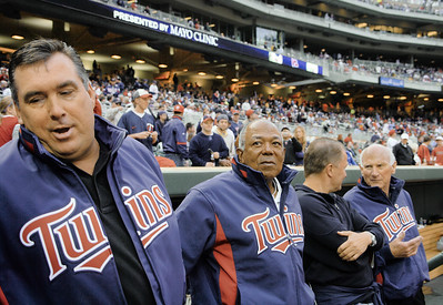 Just prior to the unveiling of their Target Field retired numbers, Kent Hrbek, Tony Oliva and Harmon Killebrew gather near the third-base dugout