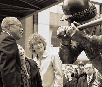 Rod Carew with his daughter and son react to his statue unveiling (sepia tone version)