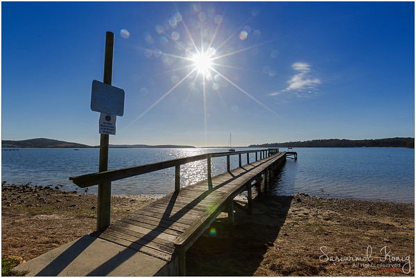 Wooden jetty on Georges Bay in St Helens, Tasmania