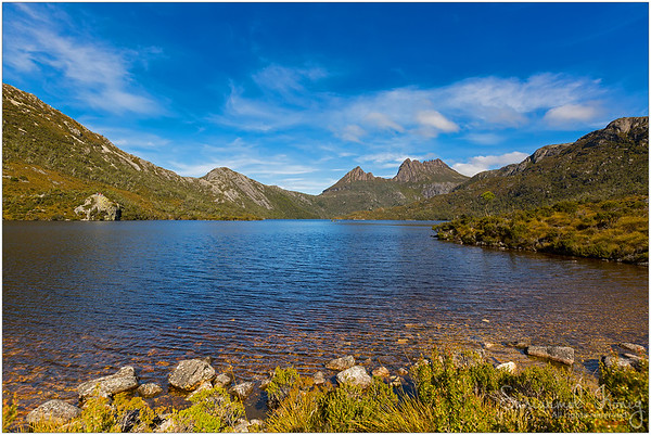 Ripples on the Dove Lake with Glacier Rock on the left. Can spot a few tourists standing atop.