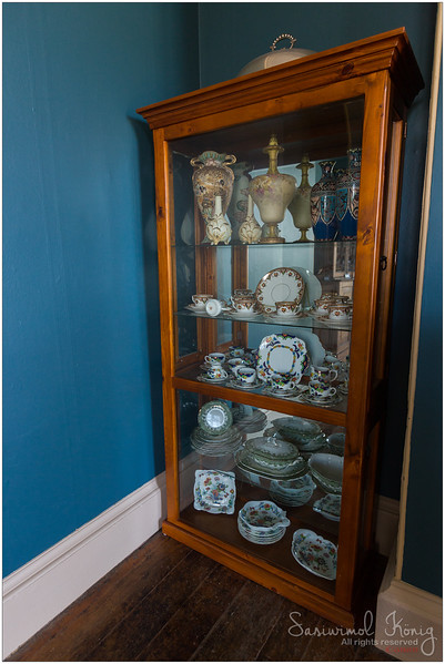 Old wooden cabinet full of pretty porcelains
