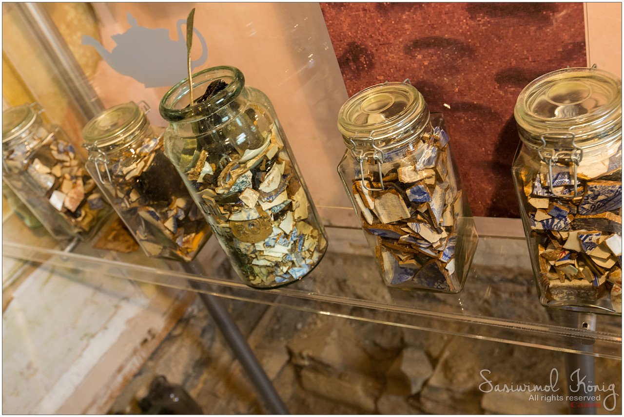 Glass and crockery shards in glass jars. Early days of the Colony, there were no potteries.. these were brought by ships from Europe and the Orient. @ China Cupboard - Room of Remnants