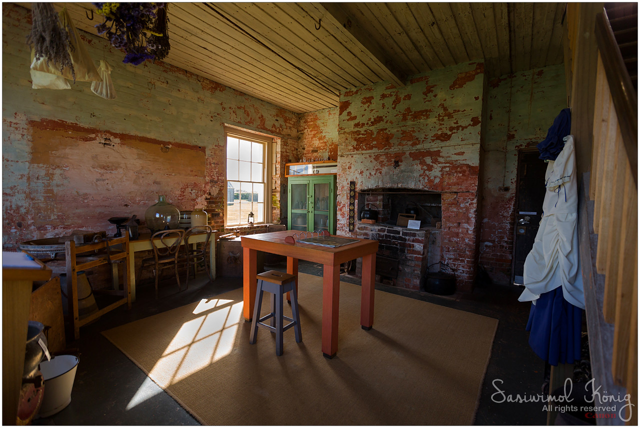 Kitchen area, Highfield House. Love the stove and green kitchen cupboard. On the left side, you can churn butter