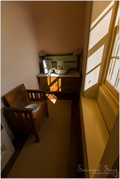 Master bedroom has a small bathroom en suite with a wash basin and a chamber pot set in a wooden chair,  Highfield House