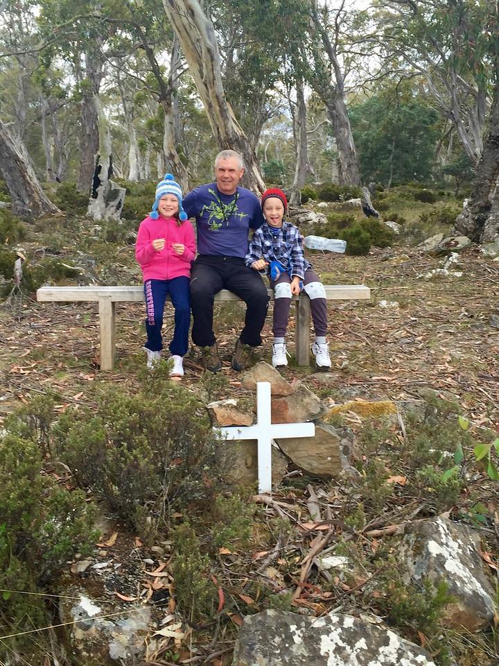 A pause at a memorial along the shore