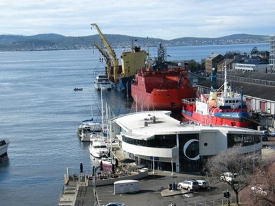 Lifting a new catamaran onto a freighter for a long distance delivery in Hobart's Sullivan's Cove.  Going by the registration on the stern, it's bound for Zanzibar. 14 August 2009