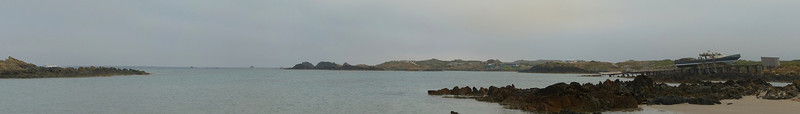 Couta Rocks panorama: one boat going ... and one staying