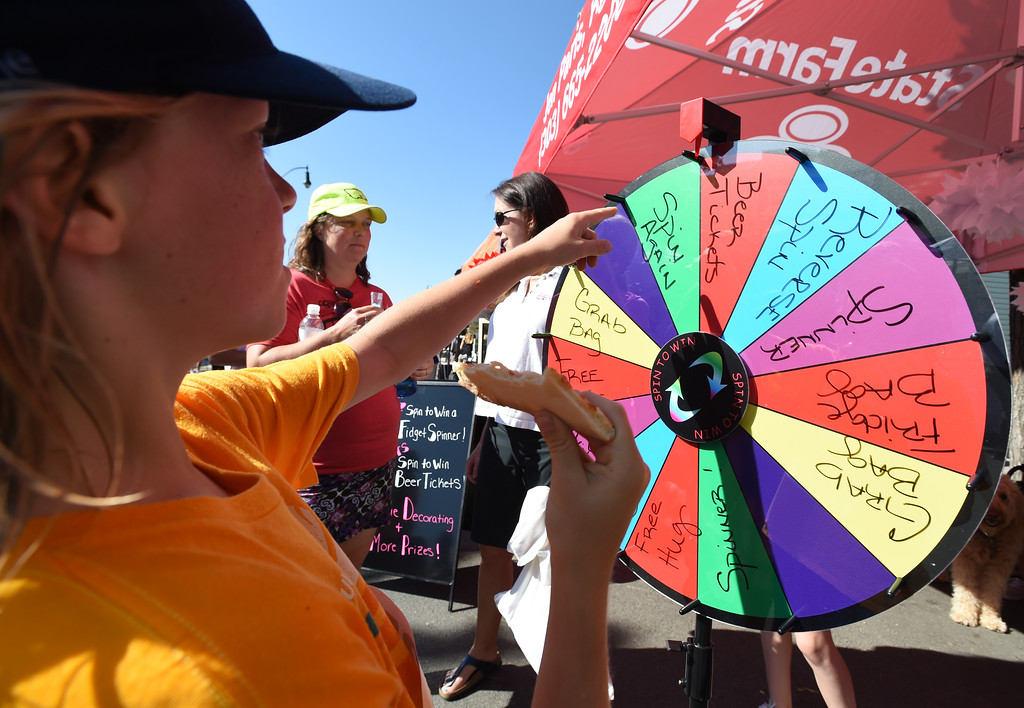 . Evan Carlson, 9, spins the gift wheel at the booth of State Farm Agent, Jen Paris. The Taste of Louisville was held on Saturday in the downtown area. For more photos, go to www.dailycamera.com.  Cliff Grassmick  Staff Photographer June 3, 2017