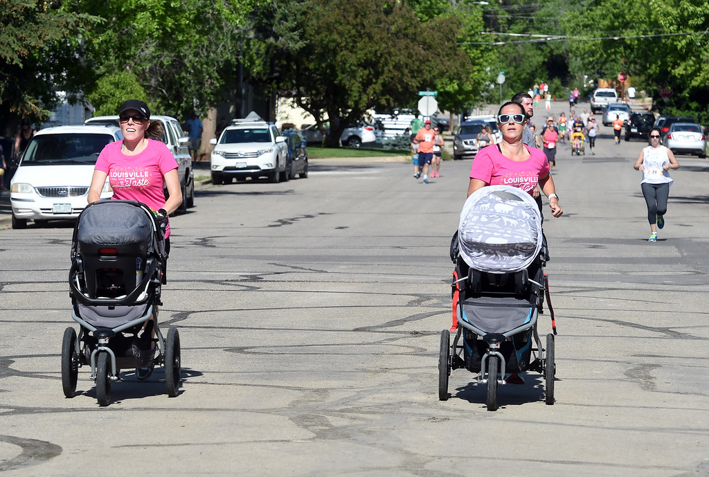 . Shannon Walla, left, and Allison Cooper-Surma, both with strollers, finish the 5K race at the festival. The Taste of Louisville was held on Saturday in the downtown area. For more photos, go to www.dailycamera.com.  Cliff Grassmick  Staff Photographer June 3, 2017