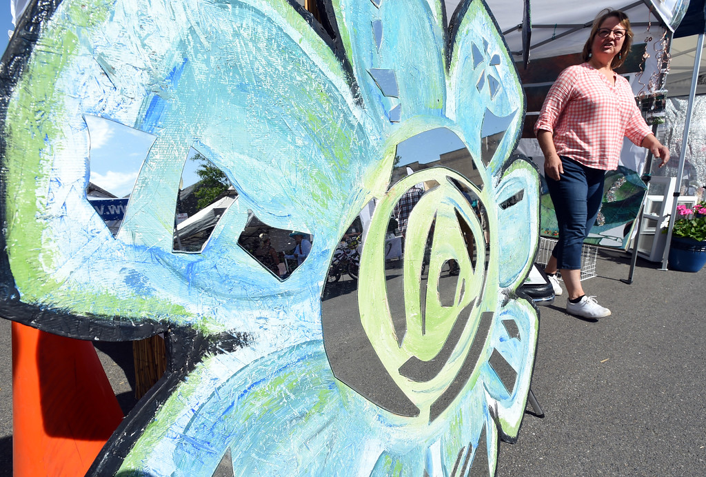 . Diana Barney, of Louisville, took a broken mirror and made an art business of it. The Taste of Louisville was held on Saturday in the downtown area. For more photos, go to www.dailycamera.com.  Cliff Grassmick  Staff Photographer June 3, 2017