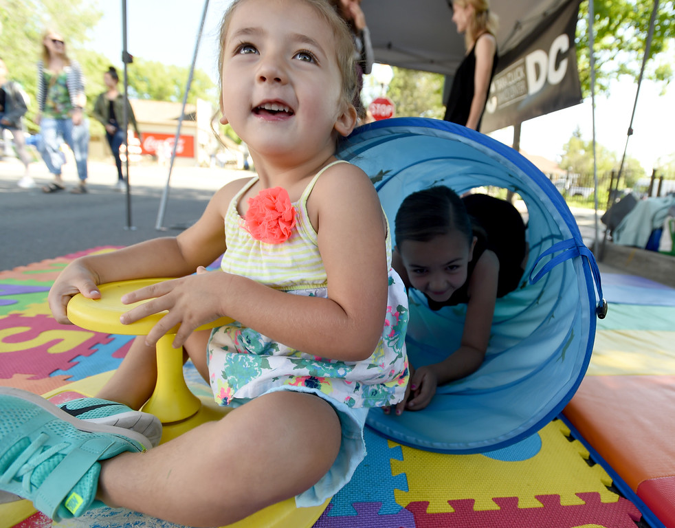 . Monroe Degraw, left and sister Mayzin, play on the obstacle course  at the Tara Cluck Dance Center Booth at the festival.The Taste of Louisville was held on Saturday in the downtown area. For more photos, go to www.dailycamera.com.  Cliff Grassmick  Staff Photographer June 3, 2017