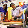 Slicing up meat for people to sample is Janet Cramb and Richard Baker of Bailey's Bar & Grill of Townsend. Nashoba Valley Voice/David H. Brow
