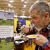 Mike Roy of Shirley trys out sample of food, mac&cheese with chicken from The Devens Grill. Nashoba Valley Voice/David H. Brow