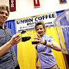 Union Coffee Roaster workers Dan Hillier of Shirley and Kelly Alsheimer of Groton armed with great coffee for people to taste. Nashoba Valley Voice/David H. Brow