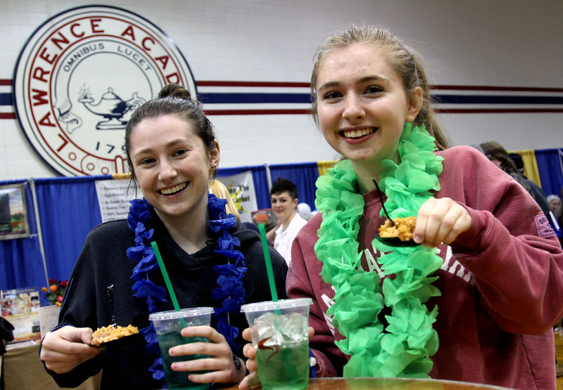 Ready to dig in to food from the Sunset Tiki Bar and Grill, are friends from Harvard L-R, Dana Noble,18, and Bridget Gibbons,17. Nashoba Valley Voice/David H. Brow