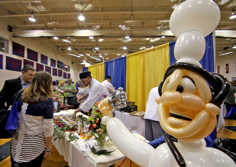 A balloon chef greets people to the food table of Devens Common Center at the Taste of Nashoba Valley event in Groton. Nashoba Valley Voice/David H. Brow
