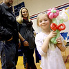 """Showing her balloon flowers just made by Dan Staples -,""""Dan's Balloons"""", is Violet Aune,6, in back are parents, Bruce Dubey and Hannah Moller from Groton. Nashoba Valley Voice/David H. Brow"""