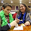 Tasting the goodies from Burton's Grill & Bar, is L-R, Nathan Frost,11 and his mom Michelle Frost from Dunstable. Nashoba Valley Voice/David H. Brow