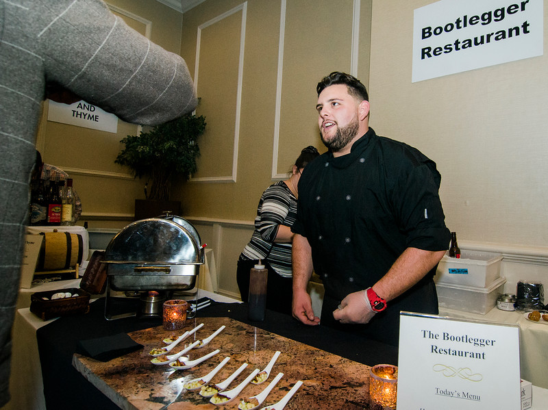 Derek Brooks serves up samples from the Bootlegger during the Annual Taste of North Central on Wednesday evening at the DoubleTree by Hilton Hotel in Leominster. SENTINEL & ENTERPRISE / Ashley Green