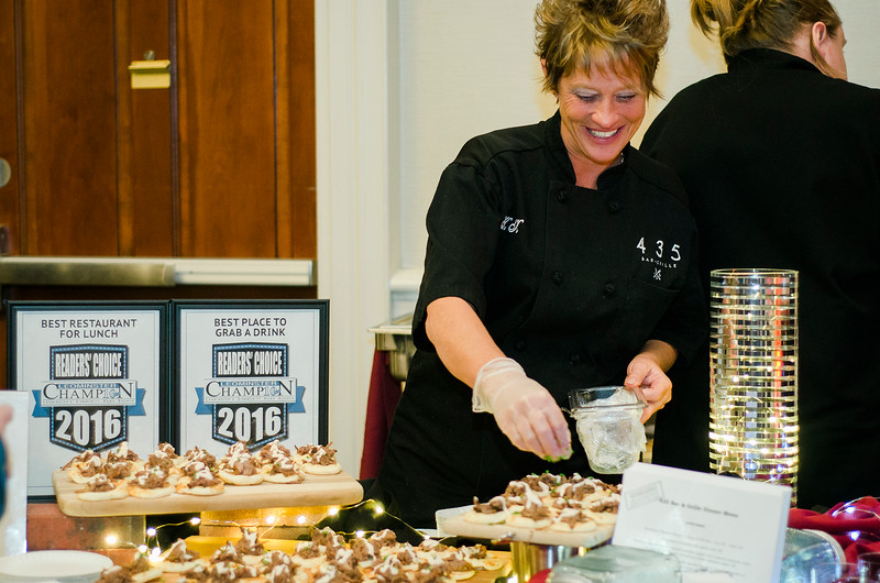 Kim Kay, of 435 Bar & Grille, serves up Korean Braised Short Ribs with Lime Chipotle Creme Fraiche during the Taste of North Central on Wednesday evening. SENTINEL & ENTERPRISE / Ashley Green