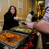 Cindy Laberge serves up samples from Il Forno during the Annual Taste of North Central was held on Wednesday evening at the DoubleTree by Hilton Hotel in Leominster. SENTINEL & ENTERPRISE / Ashley Green