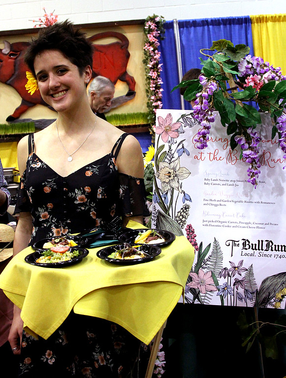 . Serving up some of the fare from the Bull Run Rest. in Shirley, is staff worker Alison Riley at the Taste of Nashoba event. Nashoba Valley Voice Photo bt David H. Brow