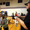 Local kids, Faith Coleman,11, and her brother Aaron Coleman,9, both of Groton, watch Dan Staples of Dan's Balloon's, make a balloon cat for them at the Taste of the Town event held at Lawrence Academy in Groton.Nashoba Valley Voice Photo bt David H. Brow.
