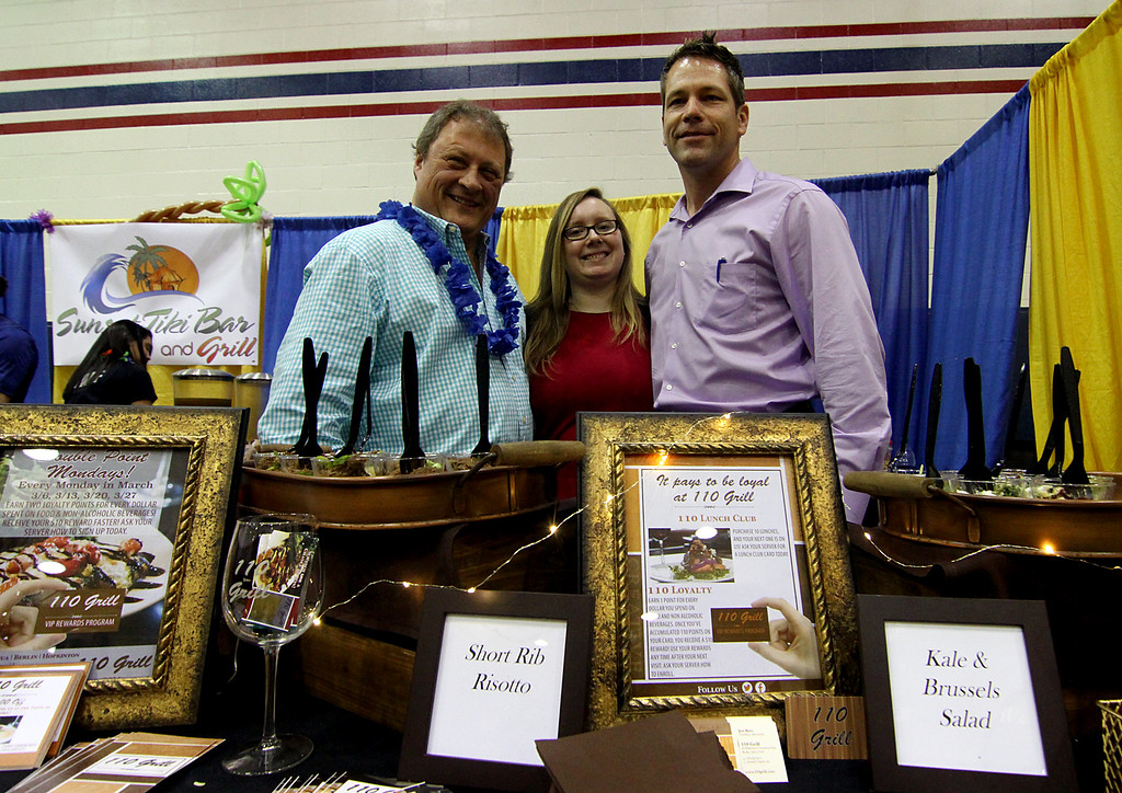 . Staffers from the Rt 110 Grill, at their table at Taste of Nashoba event, L-R, Doug McLean, Dir of Operations, Alicia Puputti, Dir of Marketing and Tim Donegan, General Manager of the Chelmsford location. Nashoba Valley Voice Photo by David H. Brow