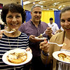 Groton residents, L-R, Diane D'Innocenzo, Frank D'Innocenzo and their daughter Ashley D'Inncenzo, sample some of the many food offered at the annual Taste of the Town event. Nashoba Valley Voice Photo bt David H. Brow