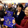 Showing the Taste of Nashoba bags at the annual event are from left, former Rep. Geoff Hall, former Rep. Bob Hargraves, Rep. Sheila Harrington, and Groton Selectwoman Anna Eliot. Nashoba Valley Voice Photo bt David H. Brow