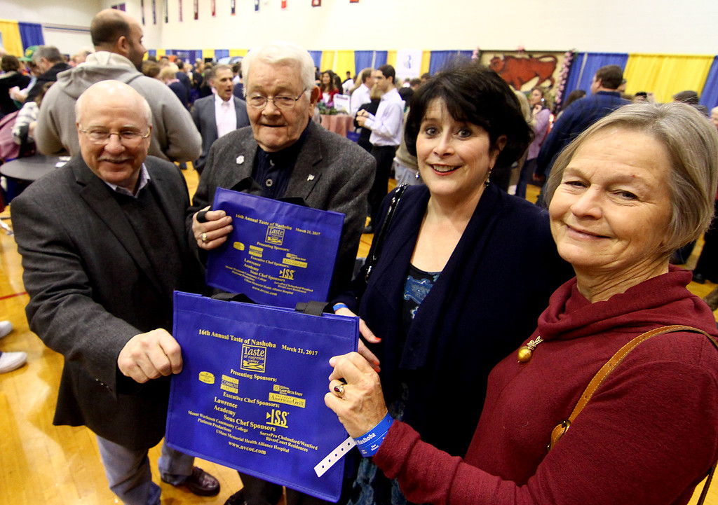 . Showing the Taste of Nashoba bags at the annual event are from left, former Rep. Geoff Hall, former Rep. Bob Hargraves, Rep. Sheila Harrington, and Groton Selectwoman Anna Eliot. Nashoba Valley Voice Photo bt David H. Brow