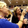 Emily Ashman, of Lunenburg, gives her daughter Iris Ashman Kelly, 15 months, ice cream as Amy Ashman holds her at Taste of Nashoba event. Nashoba Valley Voice Photo bt David H. Brow