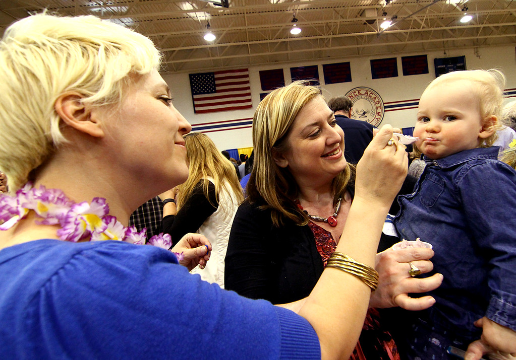 . Emily Ashman, of Lunenburg, gives her daughter Iris Ashman Kelly, 15 months, ice cream as Amy Ashman holds her at Taste of Nashoba event. Nashoba Valley Voice Photo bt David H. Brow