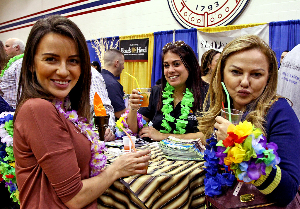 . Looking very colorful and in the spirit of the Taste of Nashoba event is L-R, Larissa Dias of Lowell, Cara Fertitta of Chelmsford and Larissa\'s mom, Debbie Dias of Lowell. Nashoba Valley Voice Photo by David H. Brow