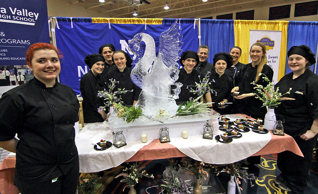 . Students and instructors form Nashoba Valley HS show off their table at the Taste of Nashoba event, L-R, Rebecca Metcalf, Shannon Benoint, Jayson Duchamre, Angela Constantine, Devin Carter, Chef Jeremy Bussire, Adam Serene, Chef Carley Capraro, Jenna Thompson and Jade Ashford.Nashoba Valley Voice Photo by David H. Brow