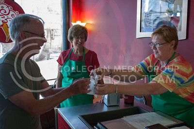 Pam Dillon and Kerry Dillon serve food during the Taste of the Ville in Manhattan, KS, on June 10, 2017.The event, which included 14 of the restaurants in the Aggieville Buisness District, was a fundraiser for the Philanthropic Educational Organization's scholarships. (Justin Wright | Collegian Media)
