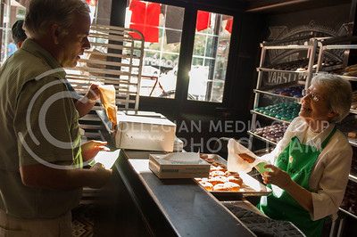 Shirley Taylor serves donuts during the Taste of the Ville in Manhattan, KS, on June 10, 2017.The event, which included 14 of the restaurants in the Aggieville Buisness District, was a fundraiser for the Philanthropic Educational Organization's scholarships. (Justin Wright | Collegian Media)