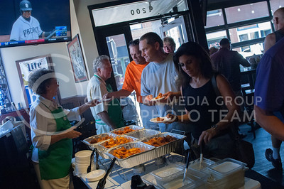 Virginia Benkelman serves food during the Taste of the Ville in Manhattan, KS, on June 10, 2017.The event, which included 14 of the restaurants in the Aggieville Buisness District, was a fundraiser for the Philanthropic Educational Organization's scholarships. (Justin Wright | Collegian Media)