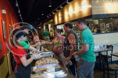 Mitchell Jerko, Anna Murphy and Anastasia King serve food during the Taste of the Ville in Manhattan, KS, on June 10, 2017.The event, which included 14 of the restaurants in the Aggieville Buisness District, was a fundraiser for the Philanthropic Educational Organization's scholarships. (Justin Wright | Collegian Media)