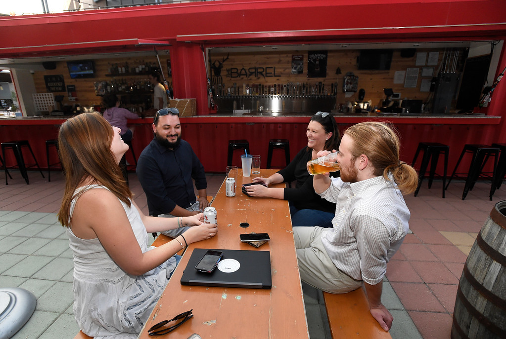 . Andy Moriarty, right, Jessica Charlesworth Brandon Maxwell and Sarah Jacobson enjoy a fresh beer together at The Barrel on the 29th Street Mall on Wednesday in Boulder. Jeremy Papasso/ Staff Photographer 8/01/18