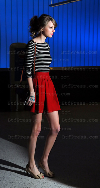 Taylor Swift arrives at LAX airport from Asia countries  on February 22,2011.