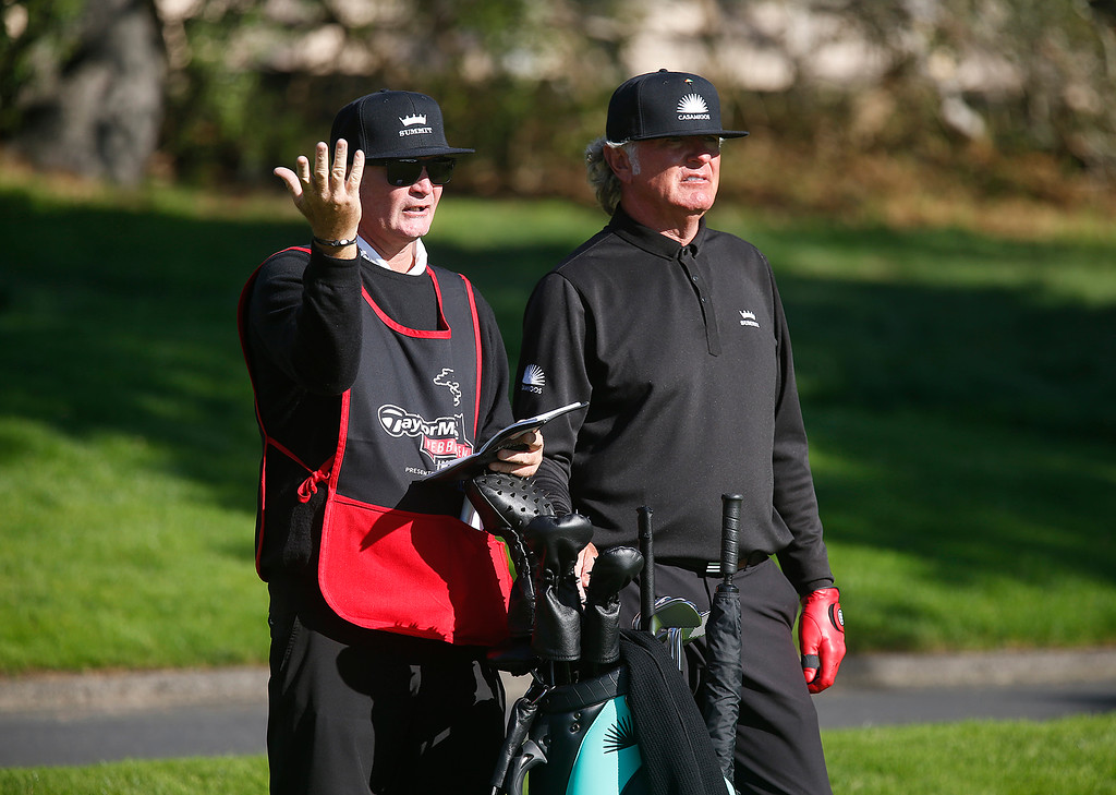 . Tommy Armour III and his caddy discuss the 16th tee shot during the final round of the TaylorMade Pebble Beach Invitational golf tournament at Pebble Beach Golf Links on Sunday November 19, 2017. (David Royal/Herald Correspondent)